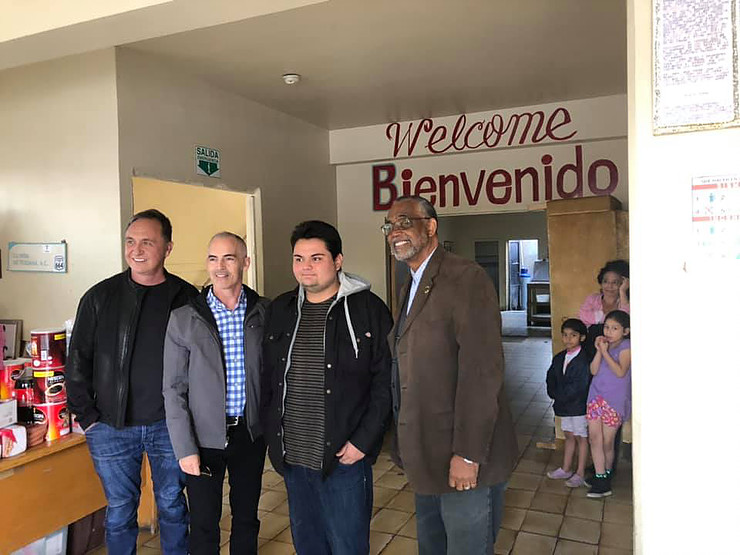 Rick Zbur (Executive Director, Equality California), Councilmember O'Farrell, Antonio Soto Aguirre (La Viña volunteer), and Councilmember Price delivering food donations.