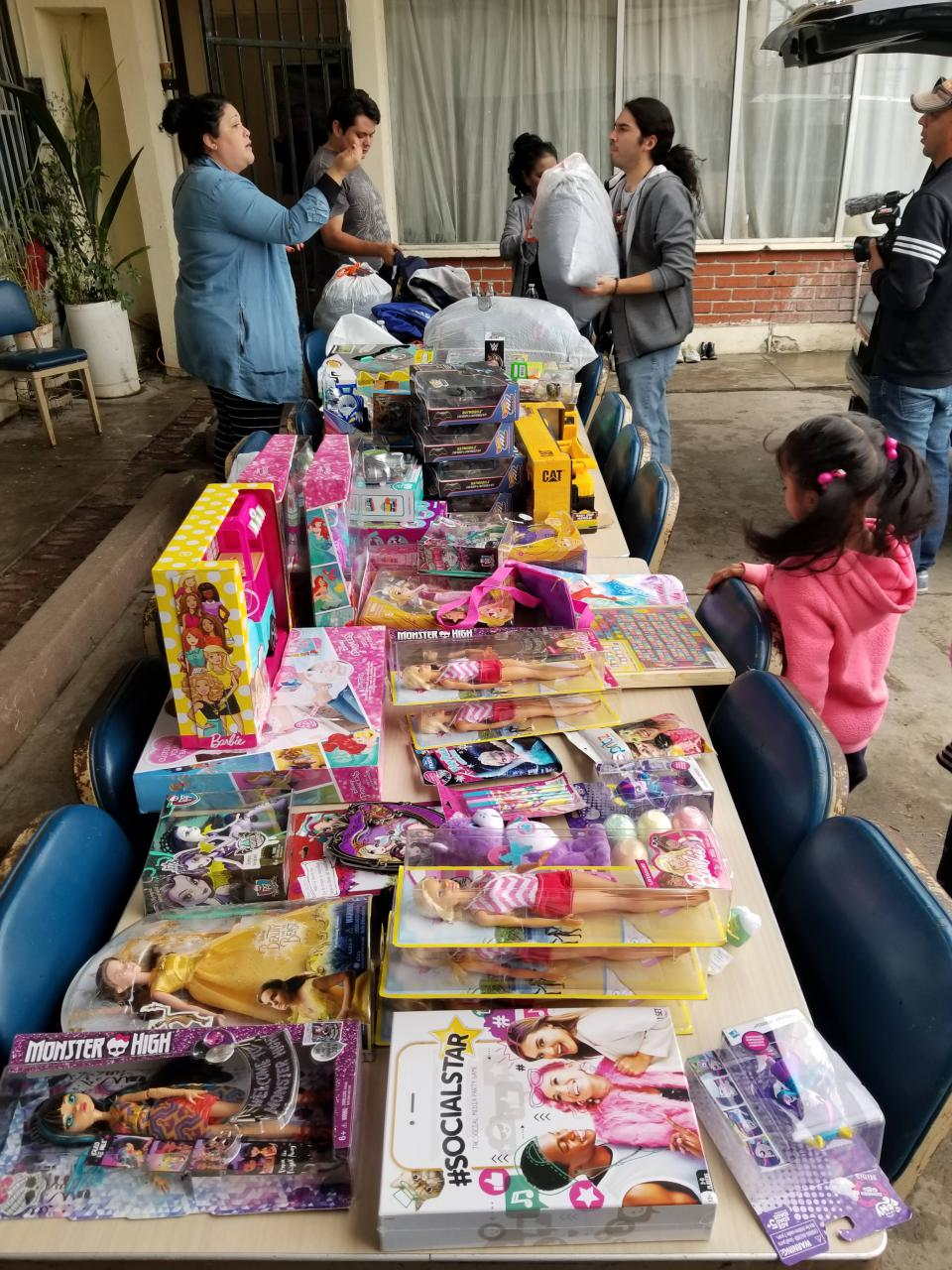 Toys and clothes for children living in a small shelter left in the wake of now emptied Benito Juarez